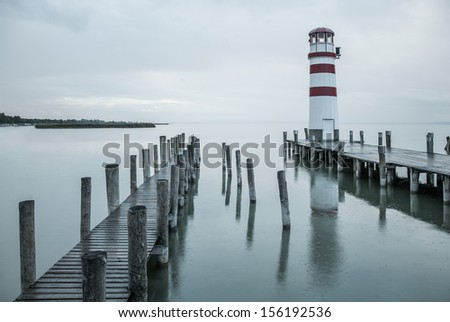 Lighthouse at Lake Neusiedl in the rain - stock photo