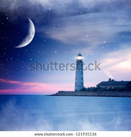 Lighthouse at night - stock photo