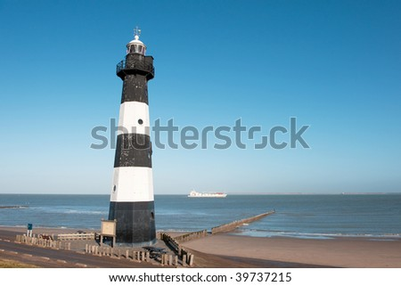 Lighthouse at the coast from Holland in Breskens - stock photo