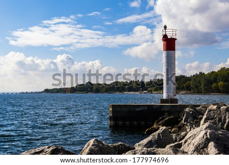 Lighthouse at the end of a Pier - stock photo