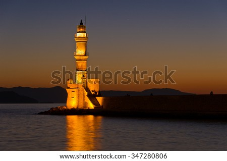 Lighthouse at the entrance of Hanja harbour. Hanja is one of the oldest cities and harbours at the island of Crete, Greece - stock photo