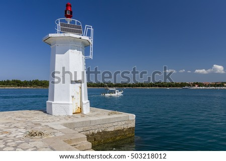 Lighthouse at the entrance to the port