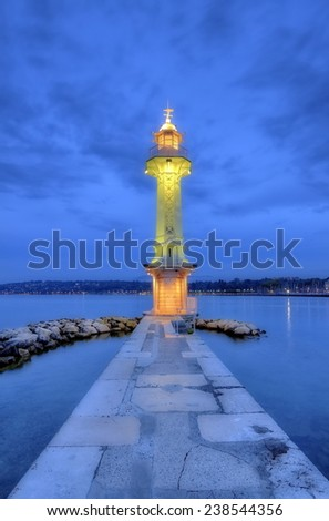 Lighthouse at the Paquis by night, Geneva, Switzerland, HDR - stock photo