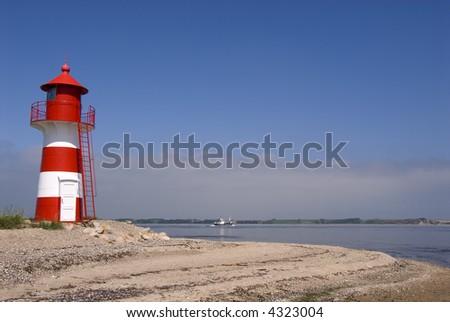 Lighthouse at the shore of limfjorden, Jutland, Denmark - stock photo