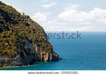 Lighthouse atop a cliff on the Italian island of Ischia in the Bay of Naples