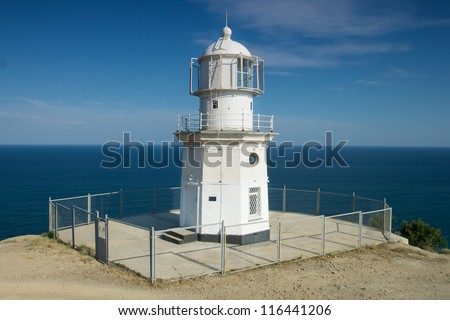 Lighthouse by the sea - stock photo