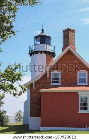 Lighthouse - Eagle Harbor Lighthouse on Lake Superior in Michigan's Upper Peninsula. - stock photo