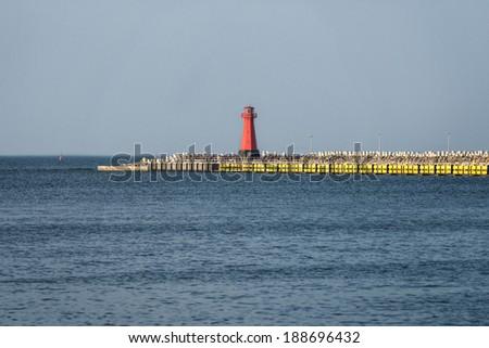 Lighthouse, entrance to the harbor, Gdansk, Poland - stock photo