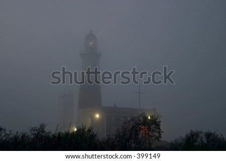 Lighthouse in a fog - stock photo
