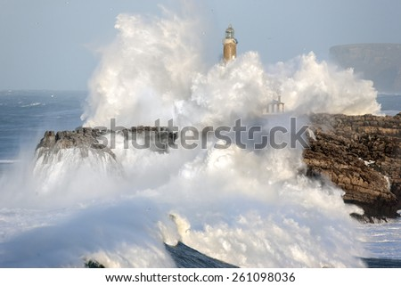 lighthouse in a storm - stock photo
