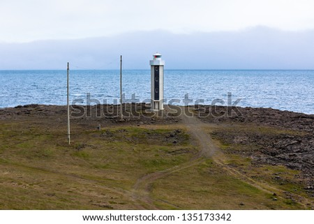 Lighthouse in East Iceland� at overcast weather. Horizontal shot