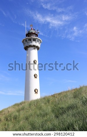 Lighthouse in Egmond aan Zee. North Sea, the Netherlands.  - stock photo