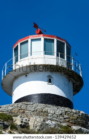 Lighthouse in front of the sky - stock photo