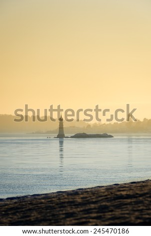Lighthouse in Oslo fjord during sundown in winter time - stock photo
