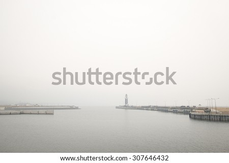 lighthouse in the fog - stock photo