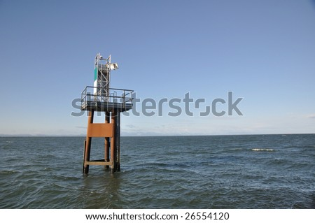 lighthouse in the sea - stock photo