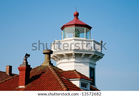 Lighthouse look-out and red rooftops - stock photo