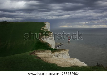 Lighthouse near the edge of famous white cliffs of Dover, England. - stock photo