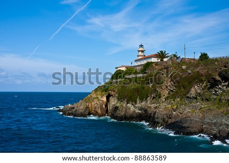 Lighthouse of Cudillero at the Bay of Biscay in Asturias, Spain - stock photo