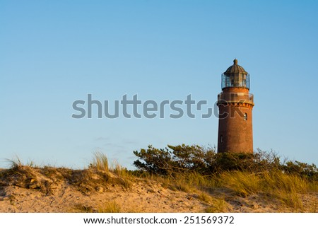 lighthouse of Darss Peninsula in Germany at sunset