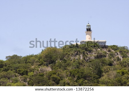 Lighthouse on a hill at a tropical Island