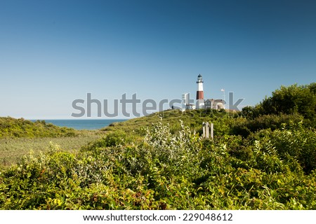 Lighthouse on a lovely summer day: Montauk Point, Long Island, New York - stock photo
