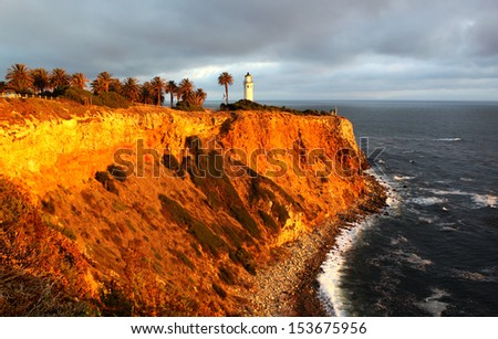 Lighthouse on a red cliff Point Vicente Lighthouse in Palos Verdes, north of Los Angeles Harbor, California, United States. The lighthouse is listed on the National Register of Historic Places. - stock photo