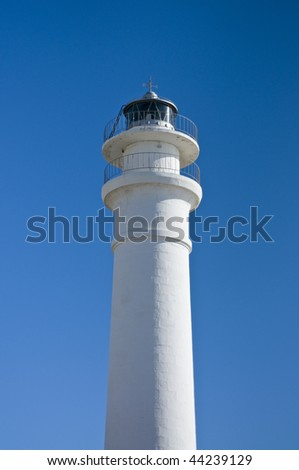 Lighthouse on blue sky