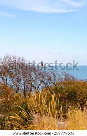 Lighthouse on Delaware Bay along the Atlantic Seashore. - stock photo