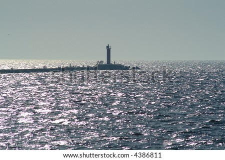 lighthouse on pier in the sea