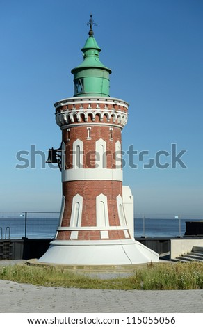 lighthouse on the background of sky and sea - stock photo