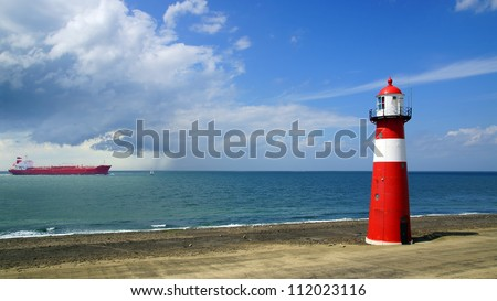 Lighthouse on the blue sky background. Westkapelle - stock photo