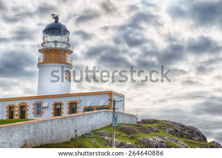 Lighthouse on the cliffs of Neist Point, a famous landmark near Glendale, Isle of Skye, Scotland, HDR version - stock photo
