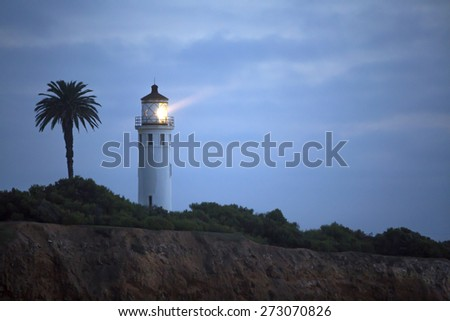 lighthouse on the coast in the night - stock photo