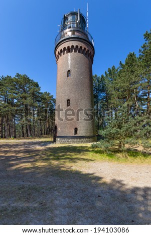 Lighthouse on the coast of the Baltic Sea in Poland - stock photo