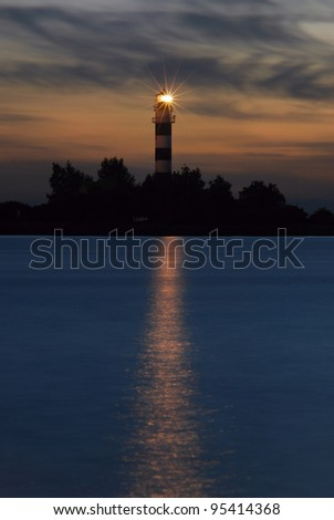 Lighthouse on the Daugava river at sunset. Port of Riga - stock photo