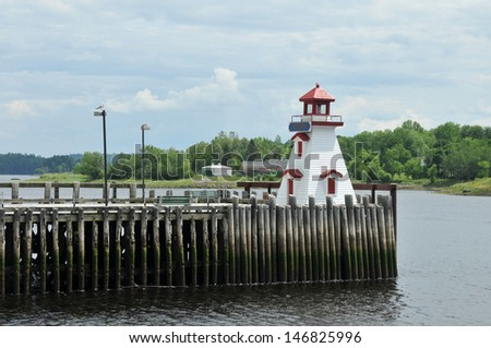 Lighthouse on the dock in St. Stephens, New Brunswick, Canada - stock photo