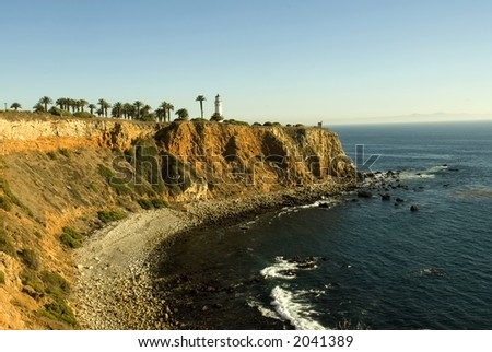 lighthouse on the golden coast of California with Pacific Ocean - stock photo