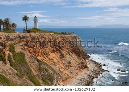 Lighthouse on the hill above ocean