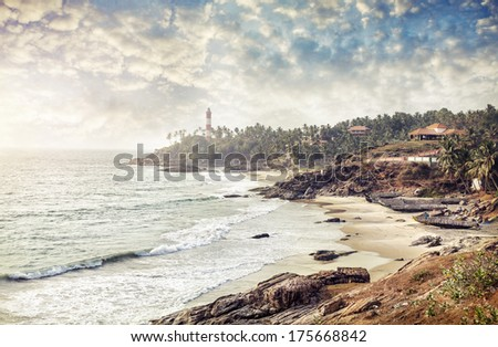 Lighthouse on the hill near the ocean at blue sky with clouds in Kovalam, Kerala, India   - stock photo