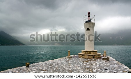 Lighthouse on the island of Lady of the Rocks, on the Bay of Kotor, Montenegro - stock photo
