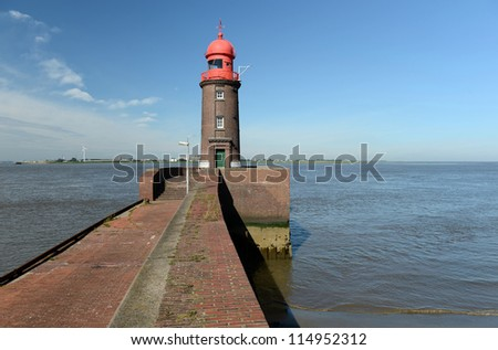 lighthouse on the pier - stock photo