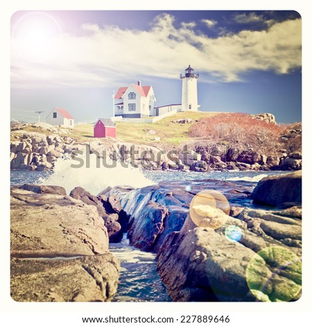 Lighthouse on top of a rocky island in Maine with Instagram effect filter - stock photo