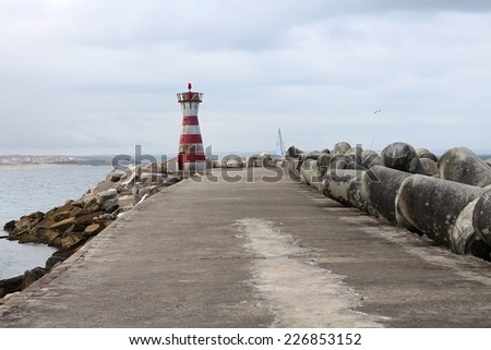 Lighthouse on wharf of Peniche, Portugal - stock photo
