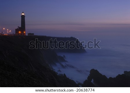 lighthouse seen from a tiny beach in S.Pedro Moel - portugal - stock photo