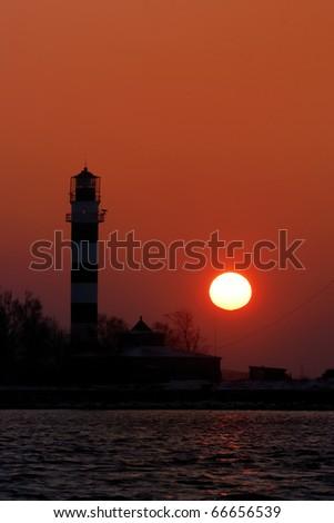lighthouse silhouette at the sunset. Riga, Latvia - stock photo