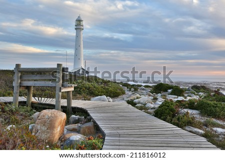 Lighthouse sunset - stock photo