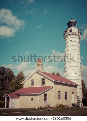 LIghthouse tower at Cana Island in Door County , Wisconsin. Instagram processing. - stock photo
