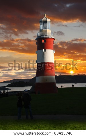 Lighthouse with amazing sunset in Plymouth, UK - stock photo