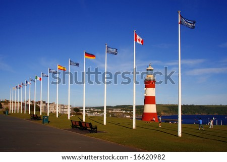 lighthouse with flags, Plymouth, UK - stock photo
